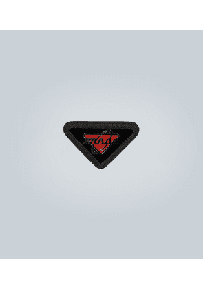 Leather-trimmed logo badge