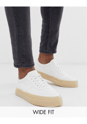 ASOS DESIGN Wide Fit trainers in white canvas with gum sole