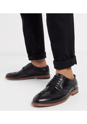 ASOS DESIGN Wide Fit brogue shoes in black faux leather
