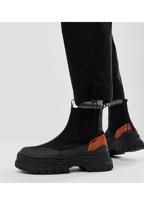 ASOS DESIGN Wide Fit chelsea boots in black with chunky sole and neon pop detail