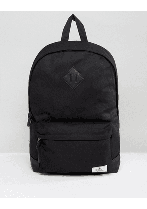 ASOS DESIGN backpack in black canvas with faux leather base and branded patch