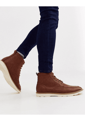 ASOS DESIGN lace up boots in tan faux leather with white sole
