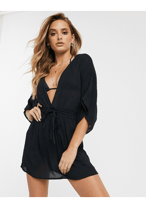 ASOS DESIGN crinkle beach cover up with channel waist & drape sleeves in black