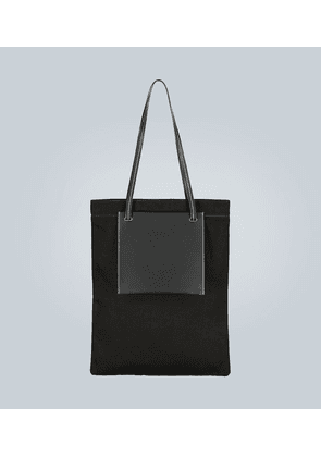 Leather-trimmed tote with pockets