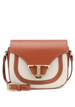 Leather-trimmed canvas crossbody bag