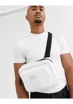 ASOS DESIGN cross body chest bag in white with contrast black zips