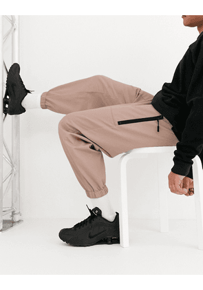 ASOS DESIGN tapered woven joggers in pink
