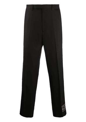 Gucci cropped logo-patch trousers - Black