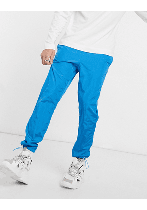 ASOS DESIGN tapered joggers in blue nylon