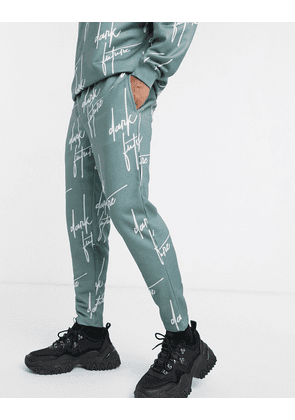 ASOS DESIGN x Dark Future co-ord slim joggers with all over logo print-Blue