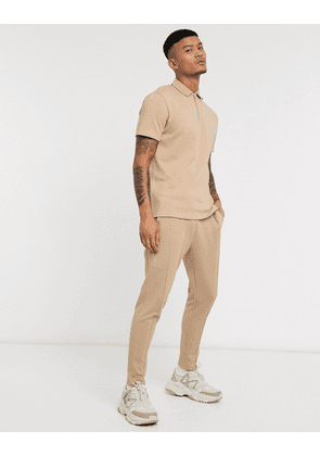 ASOS DESIGN co-ord skinny joggers in textured fabric with pintucks in beige