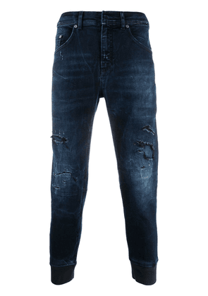 Neil Barrett elasticated ankles ripped jeans - Blue