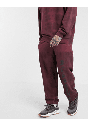 ASOS DESIGN co-ord balloon jogger with text print in washed burgundy-Red