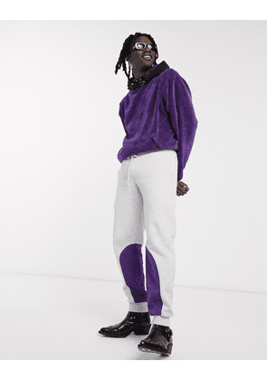 ASOS DESIGN tapered joggers in white marl with purple nylon panels