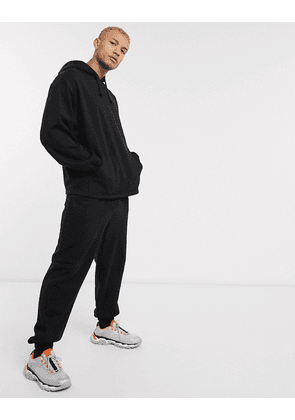 ASOS DESIGN tracksuit oversized hoodie / relaxed joggers in black