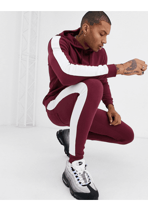 ASOS DESIGN tracksuit with hoodie & side stripe in red-Brown
