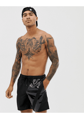 ASOS DESIGN swim shorts in black with cut and sew in mid length