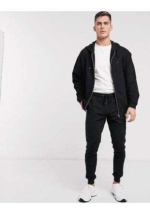 ASOS DESIGN oversized tracksuit with zip up hoodie in black