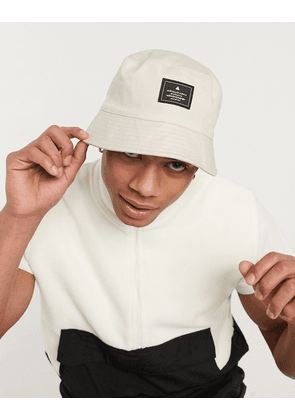 ASOS DESIGN bucket hat in beige with branded patch-Stone