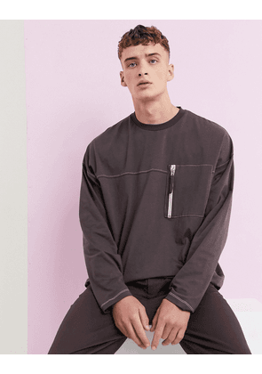ASOS DESIGN super longline oversized long sleeve t-shirt with contrast stitching and utility pocket in brown