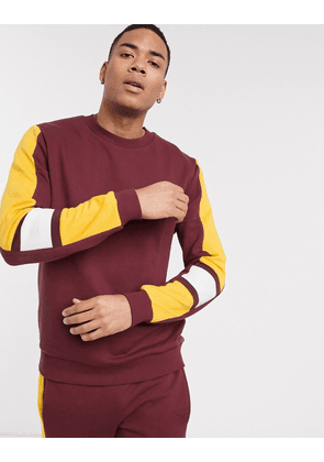 ASOS DESIGN co-ord sweatshirt in burgundy with mustard & white side tape-Red