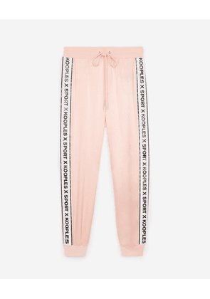 The Kooples - Flowing light pink trousers with logo trim - WOMEN