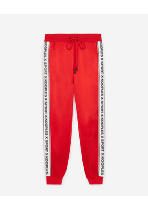 The Kooples - Flowing red trousers with logo trim - WOMEN