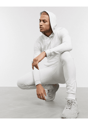ASOS DESIGN muscle tracksuit with hoodie & silver zip joggers in light grey