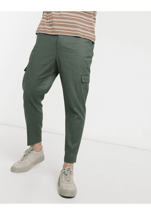 ASOS DESIGN tapered smart trousers in green linen and cargo pockets