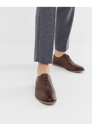 ASOS DESIGN lace up shoes in brown leather with emboss detail