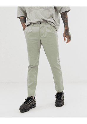 ASOS DESIGN cigarette chinos with pleats in light green