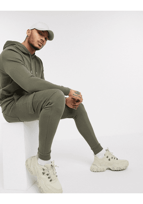 ASOS DESIGN tracksuit with hoodie & skinny cargo joggers in khaki-Green