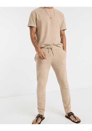 ASOS DESIGN co-ord oversized joggers in towelling in beige