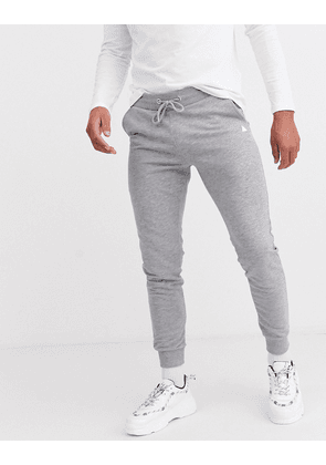 ASOS DESIGN skinny joggers in grey marl with triangle