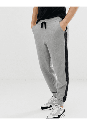 ASOS DESIGN slim joggers in grey marl with side stripe