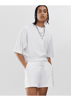 ASOS DESIGN crop oversized tracksuit/shorts in shorter length in white