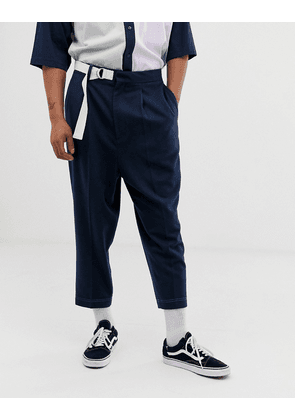 ASOS DESIGN drop crotch tapered smart trousers in navy with d-ring belt