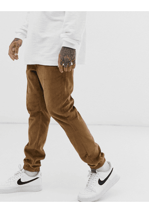 ASOS DESIGN cord tapered cuffed joggers in tan-Beige