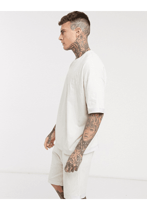 ASOS DESIGN x Dark Future lounge pyjama short and oversized t-shirt with taping in beige