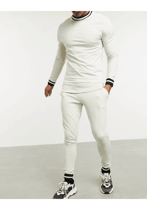 ASOS DESIGN muscle tracksuit with striped rib in beige and super skinny joggers