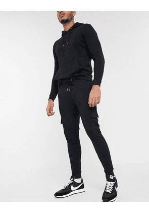 ASOS DESIGN tracksuit with hoodie & skinny cargo joggers in black