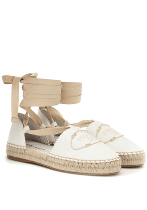 Embroidered lace-up espadrilles