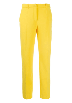 Boutique Moschino mid-rise slim-fit trousers - Yellow