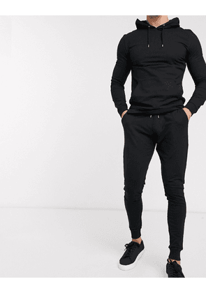 ASOS DESIGN muscle tracksuit with hoodie & extreme super skinny joggers in black