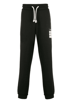 Maison Margiela patch-embellished track pants - Black