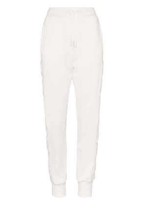 Dolce & Gabbana logo-embossed cotton track pants - White