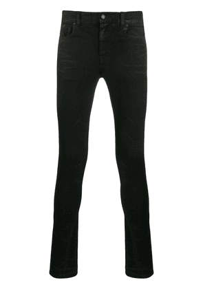 Saint Laurent lightly coated skinny jeans - Black