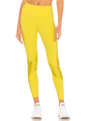ALALA Peak Tight in Lemon. Size L.