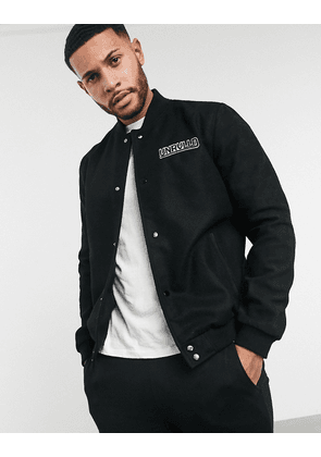 ASOS DESIGN leather varsity bomber with Unrivalled Supply logo in black
