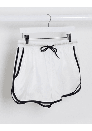 ASOS DESIGN runner swim shorts in clear ripstop with black binding and white inner trunk